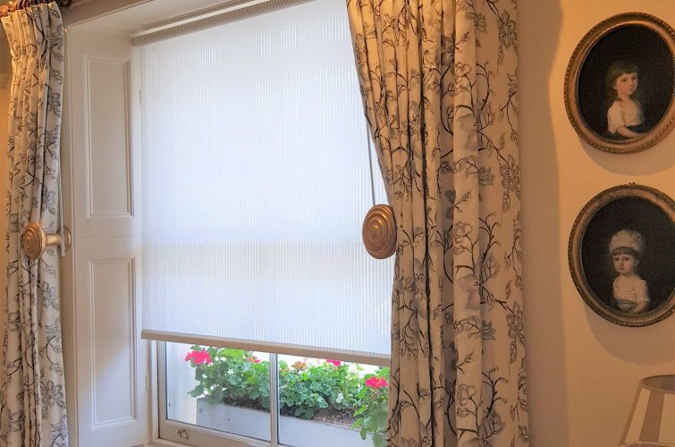 Curtains on pole over shutter boxes