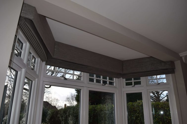 Structured pelmets and Roman Blinds on a Bay min