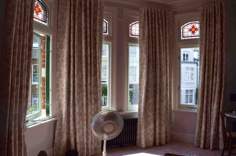 Cartridge headed curtains on bay corded poles min